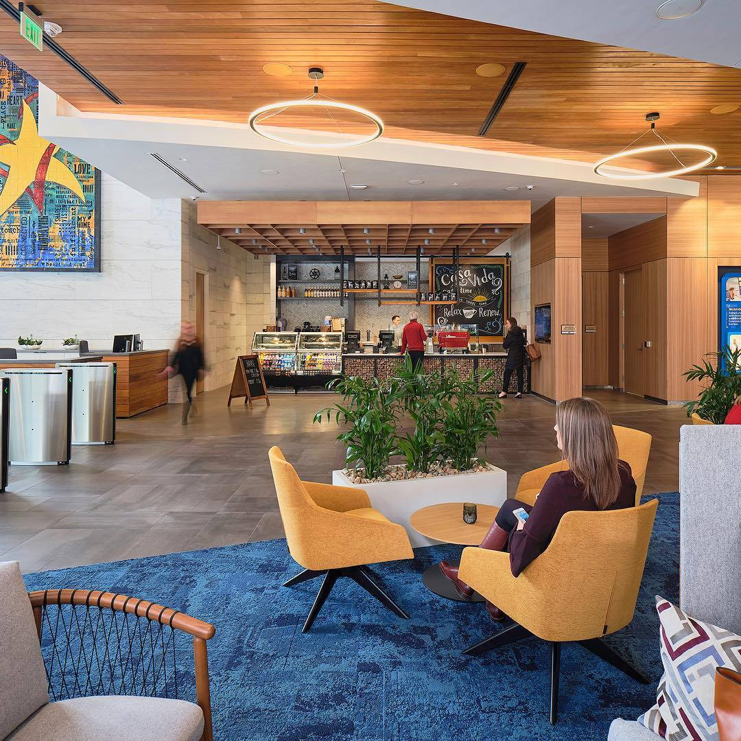 The newly designed lobby at @davita is the meeting place of choice of their downtown Denver campus; a tenant entry like no other.  #coffee #coffeeshop #office #buildinglobby #gatheringplace #welistenthencreate @acquilano_