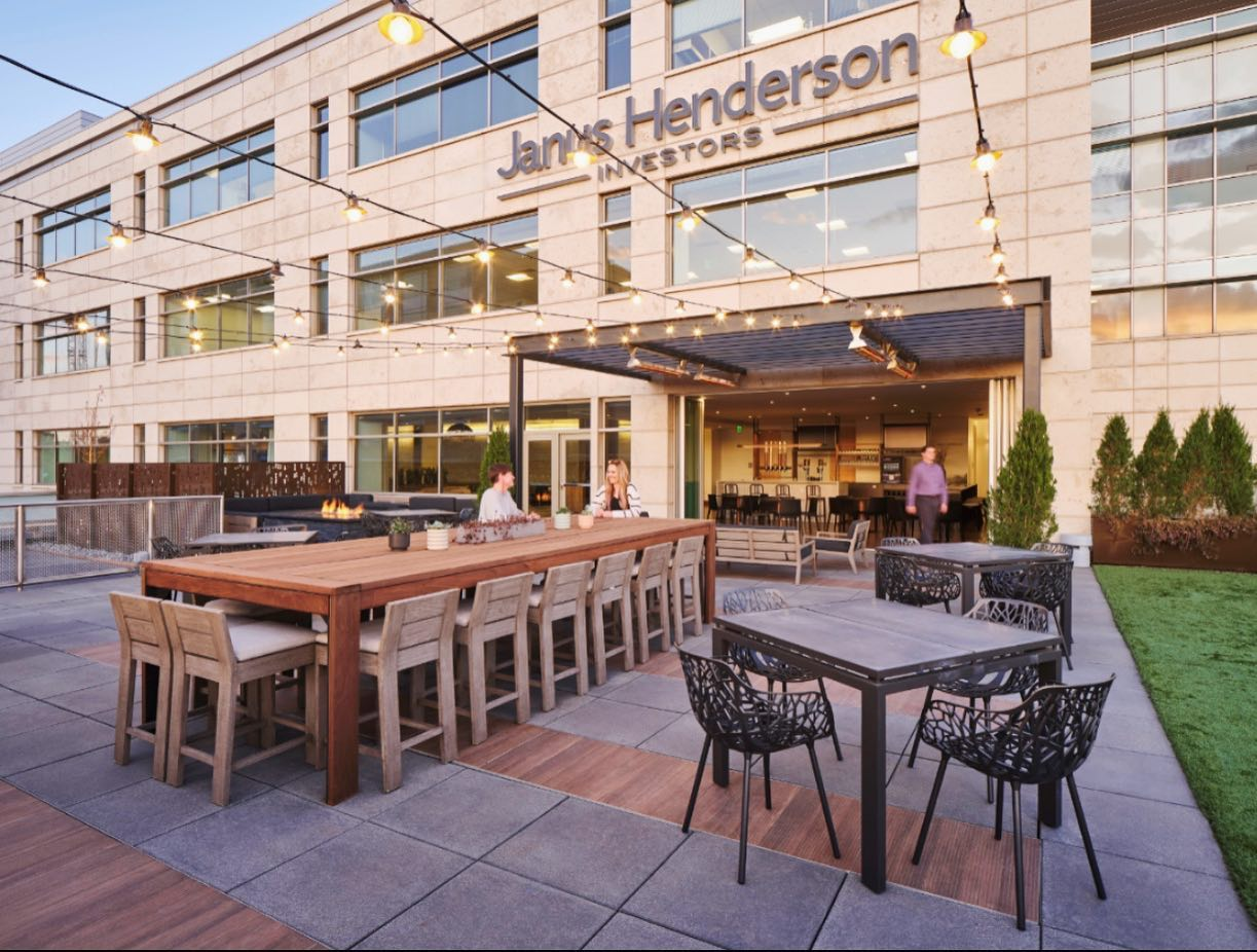 We love reimagining under utilized spaces for our clients!  Take a look at this inviting outdoor patio that connects to the indoor work lounge with a full glass moveable wall at Janus Henderson's Cherry Creek office. #rooftop #patio #workplacedesign #cherrycreeknorth #officedesign #welistenthencreate #colorado