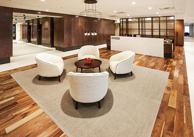 With modern, unique light fixtures, rich wood tones, and high contrast furnishings, employees and guests receive a warm and sophisticated greeting when entering Gordon & Rees's Denver office.  #welistenthencreate #acquilanodesign #interiordesign #interiorarchitecture #corporatedesign #officedesign #modern #contemporary #wooddetails #texture #denver #colorado #lawfirmdesign #sophisticated #modernworkplace #workplacewednesday #corporateinteriors